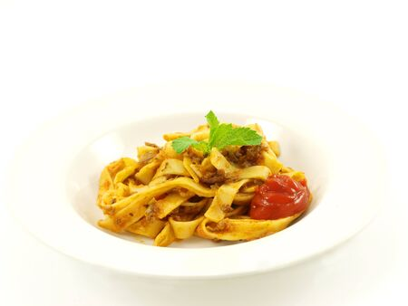 Pasta with meat sauce on towards white background