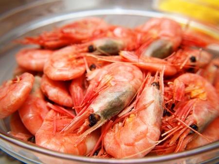 Whole fresh raw prawns in shell, macro, in a bowl photo