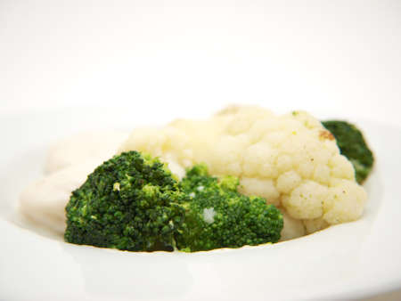 Broccoli and cauliflower isolated on white plate, towards white background Stock Photo