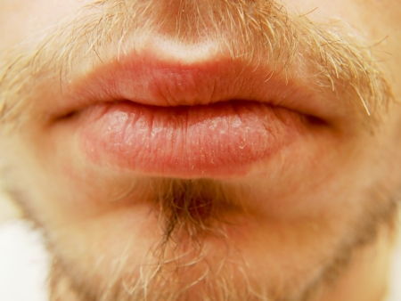 Closup of dry male lips, surrounded with beard Stock Photo
