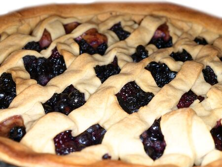 Fresh dark blue berry pie, covered with shortcrust pastry Stock Photo