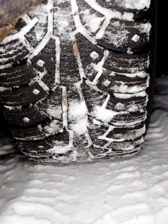 winter tire tracks in snow, closeup, focus on tire