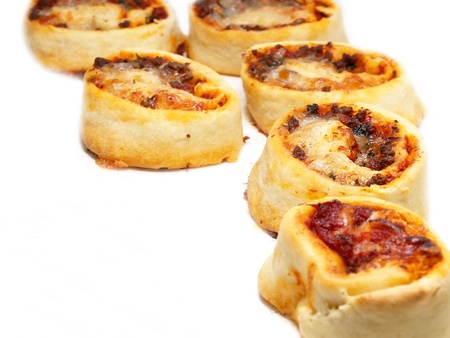 Small sized round pizza portions, in groups, towards white Stock Photo