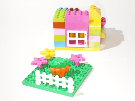 Colorful plastic quick build toys, towards white background