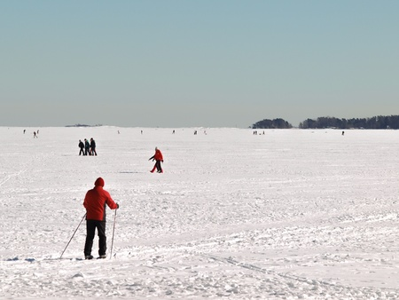 black ski pants: Person on skiis, at frozen waters, clear blue sky Stock Photo