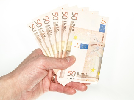 Male person handing over 50 euro bills towards white photo