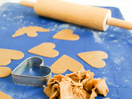 nonstick: Gingerbread baking on blue nonstick silicone mat Stock Photo