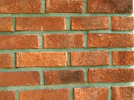 Closeup of a red brick wall with sunlight, creating natural ligh effects Stock Photo