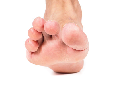 One single male foot stepping towards, isolated on white Stock Photo