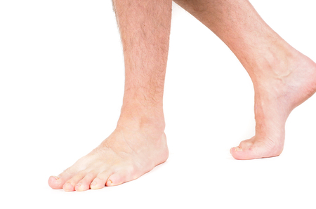 bare foot: Young male person walking barefooted isolated on white Stock Photo