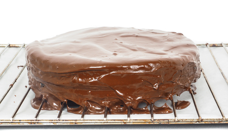 torte: Chocolate icing dripping off from freshly made sacher torte cake Stock Photo