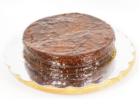 torte: Half stage on sacher torte chocolate cake on silver mirror plate towards white