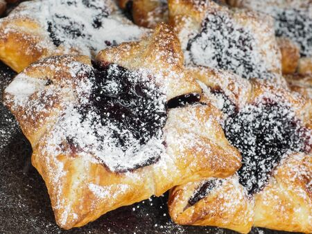 Danish pastry with blueberry jam filling with white powdered sugar