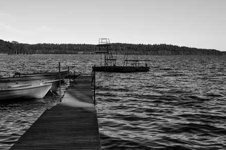 A small jetty with a few boats in a lake
