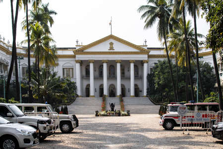 Kolkata, India - February 1, 2020: View over the exterior of the government building Raj Bhavan with several cars parke outside on February 1, 2020 in Kolkata, India Editöryel