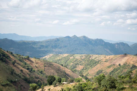 Beautiful rolling hills underneath some clouds along the hike from Kalaw to Inle Lake, Myanmar