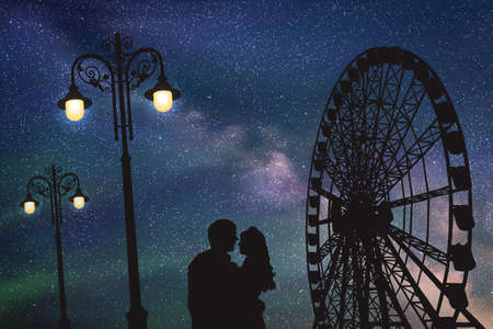 Lovers in amusement park at night. Vector illustration with silhouette of loving couple under starry sky. Vintage lampposts and Ferris wheel Illustration