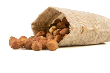 burlap bag: nuts in a burlap bag isolated on white background