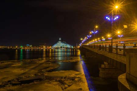 Panorama of illuminated bridge in Riga, Latvia Editorial