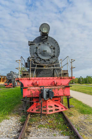 Old steam locomotive train under blue sky