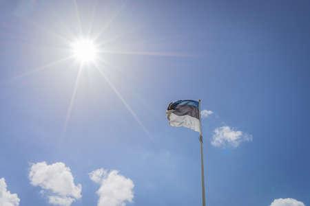 tallin: Waving Flag of Estonia, Blue, Black and White Stock Photo