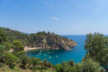 Coves of Cala Llorell beach in Tossa de Mar, Spain