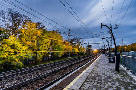 Railroad platform in autumn, with long exposure Stock Photo