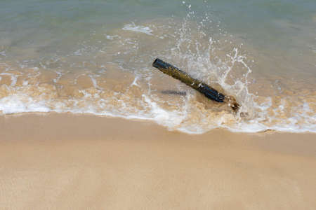 Old tube from the Sand in beautiful beach Фото со стока