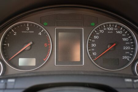car black interior: dashboard, speedometer and tachometer and other buttons.