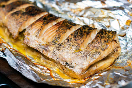 lying down fish cooking in the oven, pike lie in a foil