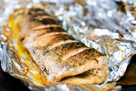 lying down fish cooking in the oven, pike lie in a foil Banco de Imagens