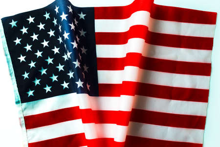 Waving american flag and shape inscription v or victory USA election concept. 免版税图像
