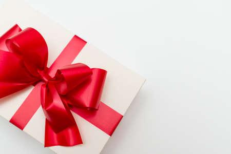 Top view Cristmas white gift box present red bow white studio background. Stock Photo