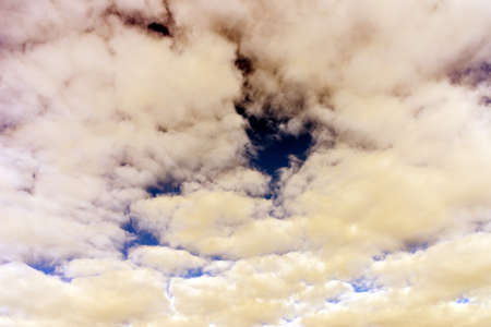 Cloud and blue skay background.Dramatic nice white clouds on a blue heaven.Toned.