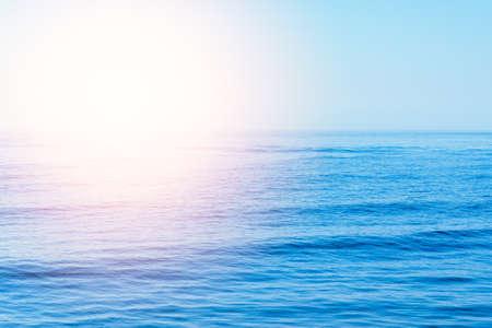 beautiful sunset or sunrise waves on the beach. blue sky and calm empty beach landscape.