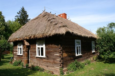 Very old cottage with wood from Poland photo