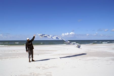 briny: Stagnant man holds screen picked out on beach by wind  Stock Photo