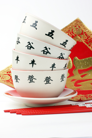 chop sticks: Chop sticks and a red bowl Stock Photo