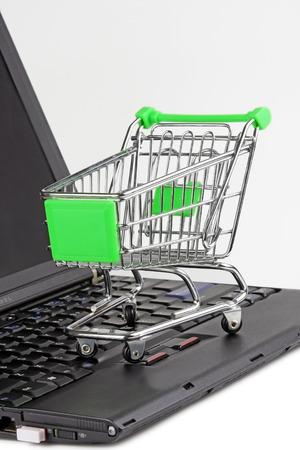 Mini shopping cart and computer photo