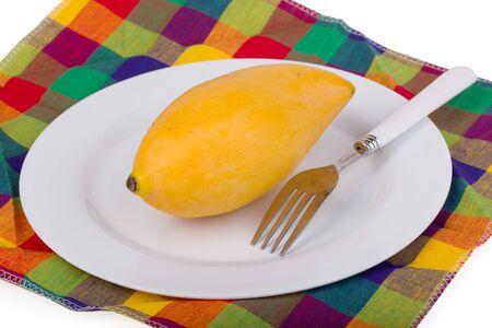 gingham: Ripe mango on check gingham background