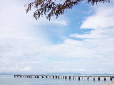 toward: Long wooden bridge toward the sea