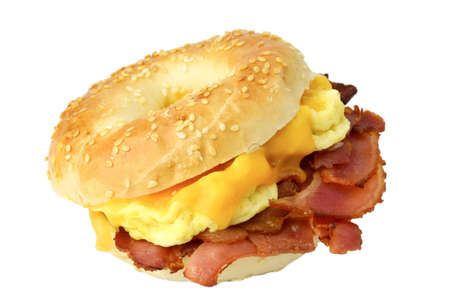 Bagel with fried bacon, scrambled eggs and cheddar cheese, studio isolated