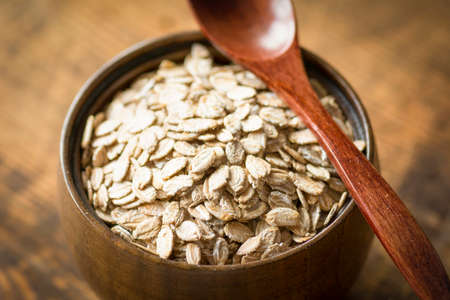 close up food: Rolled oats in brown bowl, close up food ingredients