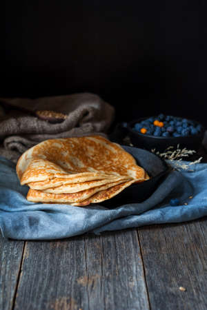 blini: Blintzes or blini - russian crepes. Rustic still life Stock Photo