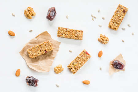snack bar: Granola bars or energy bars with nuts, oats and dried fruits on white background Stock Photo