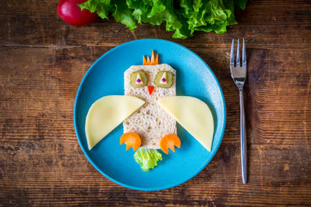 healthy lunch: Breakfast for kids: funny healthy sandwich on plate Stock Photo