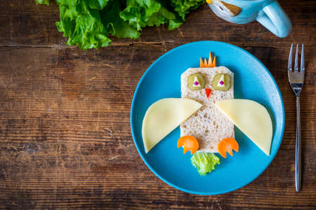 meal: Breakfast for kids: funny healthy sandwich on plate and copy space Stock Photo