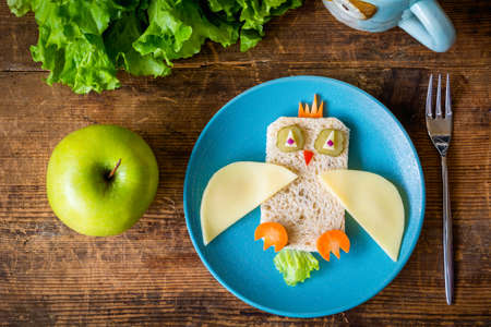 multi grain sandwich: Healthy lunch for kids: funny vegetable sandwich on plate Stock Photo