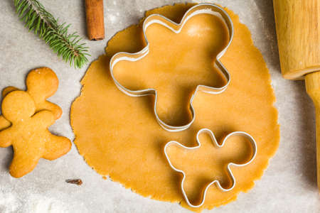 Gingerbread cookie dough and christmas cookie cutters. Baking holiday cookies