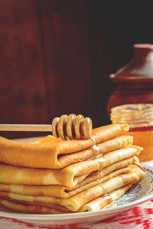 maslenitsa: Stack of pancakes with honey. Russian blini for Maslenitsa
